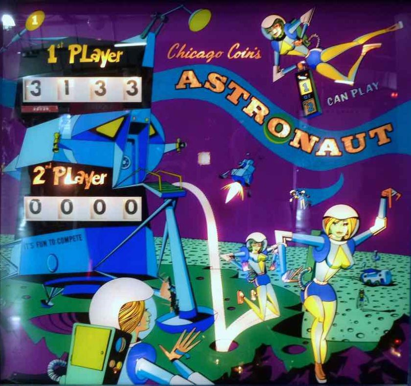 Christian Marche-designed backglass for the Astronaut pinball machine, featuring very small women in skintight suits bounding out of the Lunar Module and hopping around the green Swiss Cheese lunar landscape.