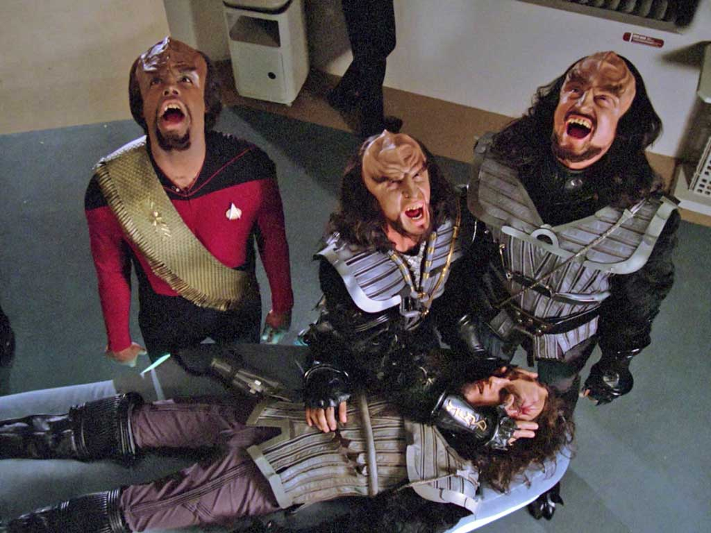 Worf and two guest Klingons of the week standing in sickbay over the body of a dead guest Klingon of the week. All but the dead one are howling at the boom mike.